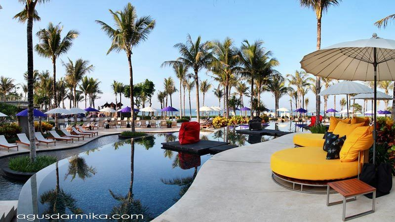 Bali beach clubs: Poolside area with comfy daybeds at W Retreat and Spa