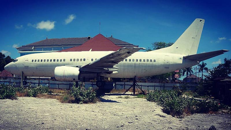Abandoned airplanes in Bali: This aircraft is wedged between houses in South Kuta