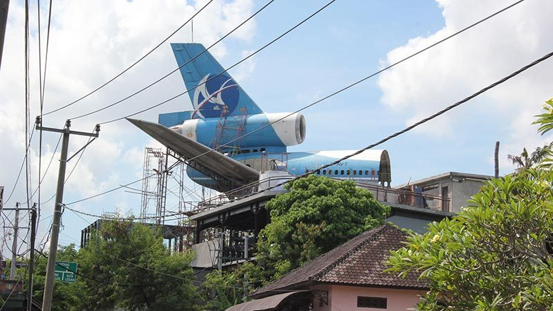 Abandoned airplanes in Bali: A part of DC 10 fuselage on the roof of Arena Restaurant
