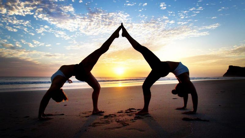 Things to do in Bali when it rains: Yoga on the beach